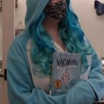 Blossom Kravitz dressed as narwhal with blue wig