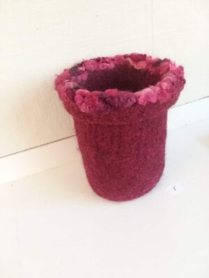 Red knitted, felted and embellished vase by Lyn Mayewski