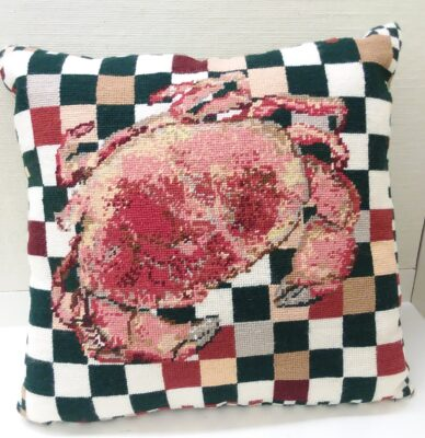 Needlepoint pillow with a crab and green and white checked background