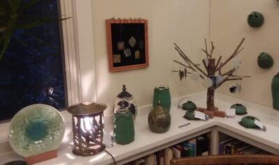 Pottery lamp, vase, necklaces, and ornaments by Cathy Rees.