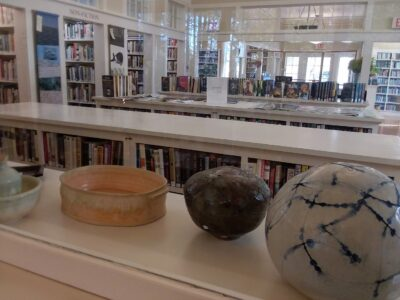 pottery and library shelves