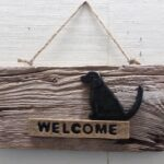 Welcome pottery on driftwood by Elsie Sealander