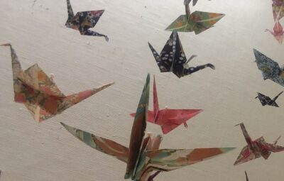 origami cranes hanging from clear string