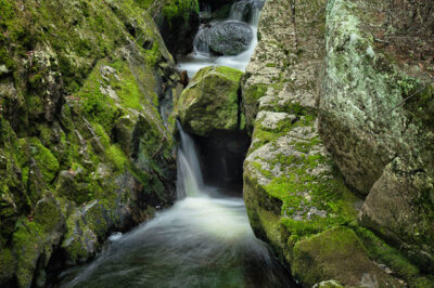 water fall with mossy rocks