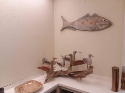 image of wooden fish sculpture, wooden bird sculpture and pottery