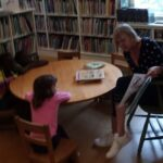 Lisa DePasqual with kids reading a story